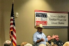 "Blake ""Cowboy"" Stephens speaking at the Edmond Republican Women's Club at their Gubernatorial Forum. Dan Fisher and Gary Richardson are pictured in the background."
