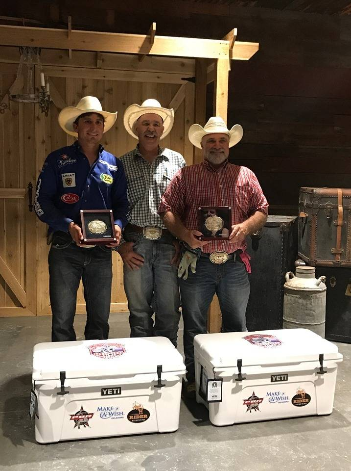 Larry Tysver, Cavender's Manager, presents the buckles and ice chests to Cowboy and his roping partner, Professional Bull Rider Ryan Dirteater! They won the Ryan Dirteater Make a Wish Roping.
