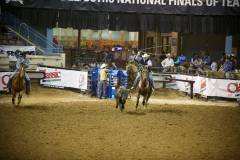 Action photos of Blake roping his steer at the National Finals of Team Roping Championships. 2/11