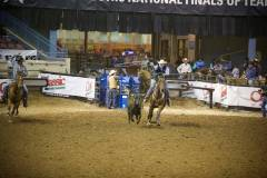 Action photos of Blake roping his steer at the National Finals of Team Roping Championships. 3/11