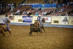 Action photos of Blake roping his steer at the National Finals of Team Roping Championships. 10/11